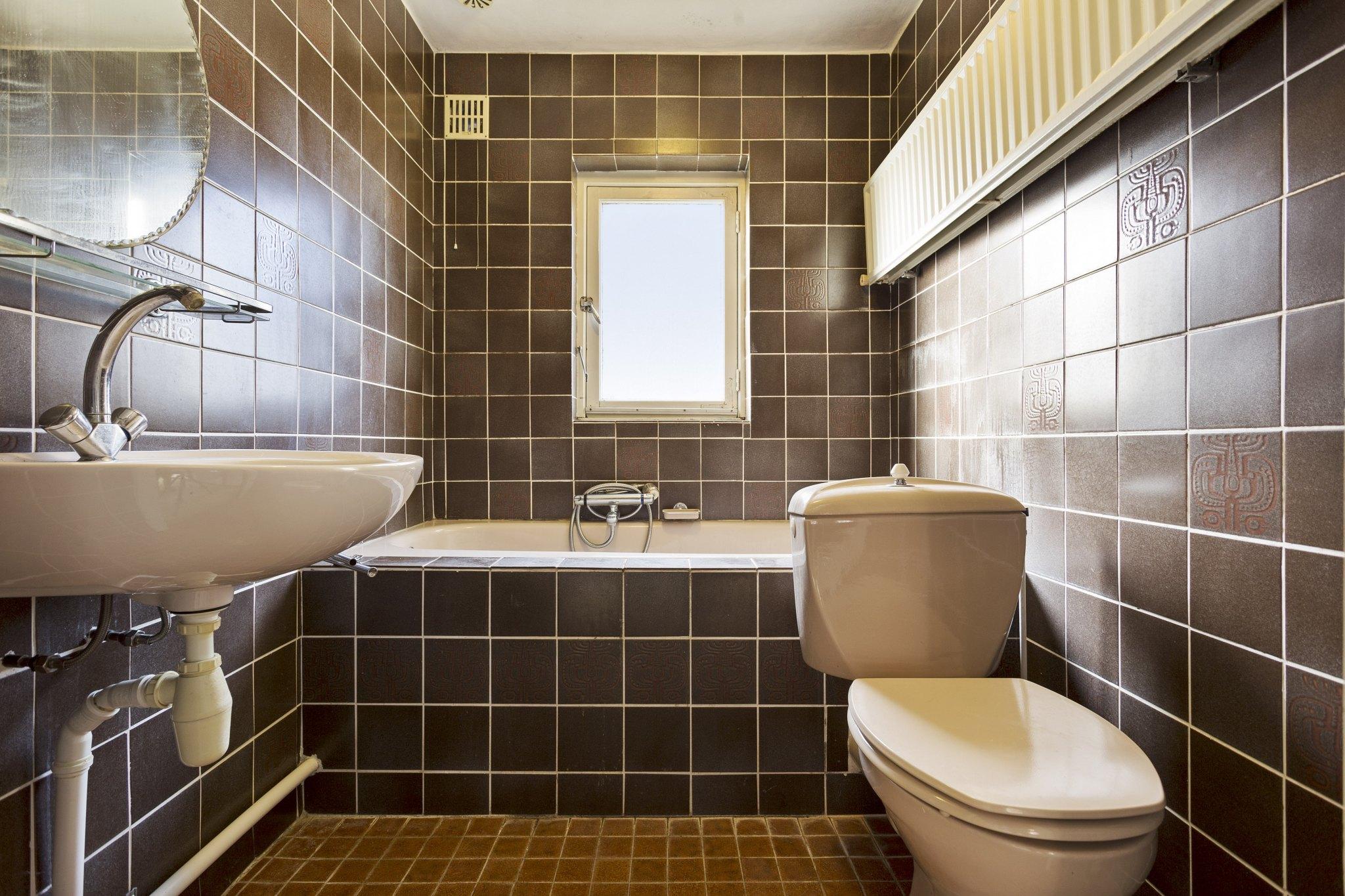 Badkamer -- Vrijstaande woning te koop in Made